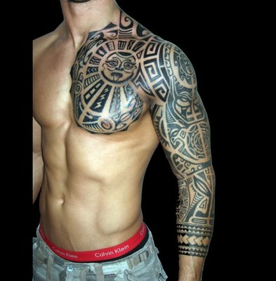27_tribal-rock-styled-tattoo-on-arm-and-chest_540x550.jpg